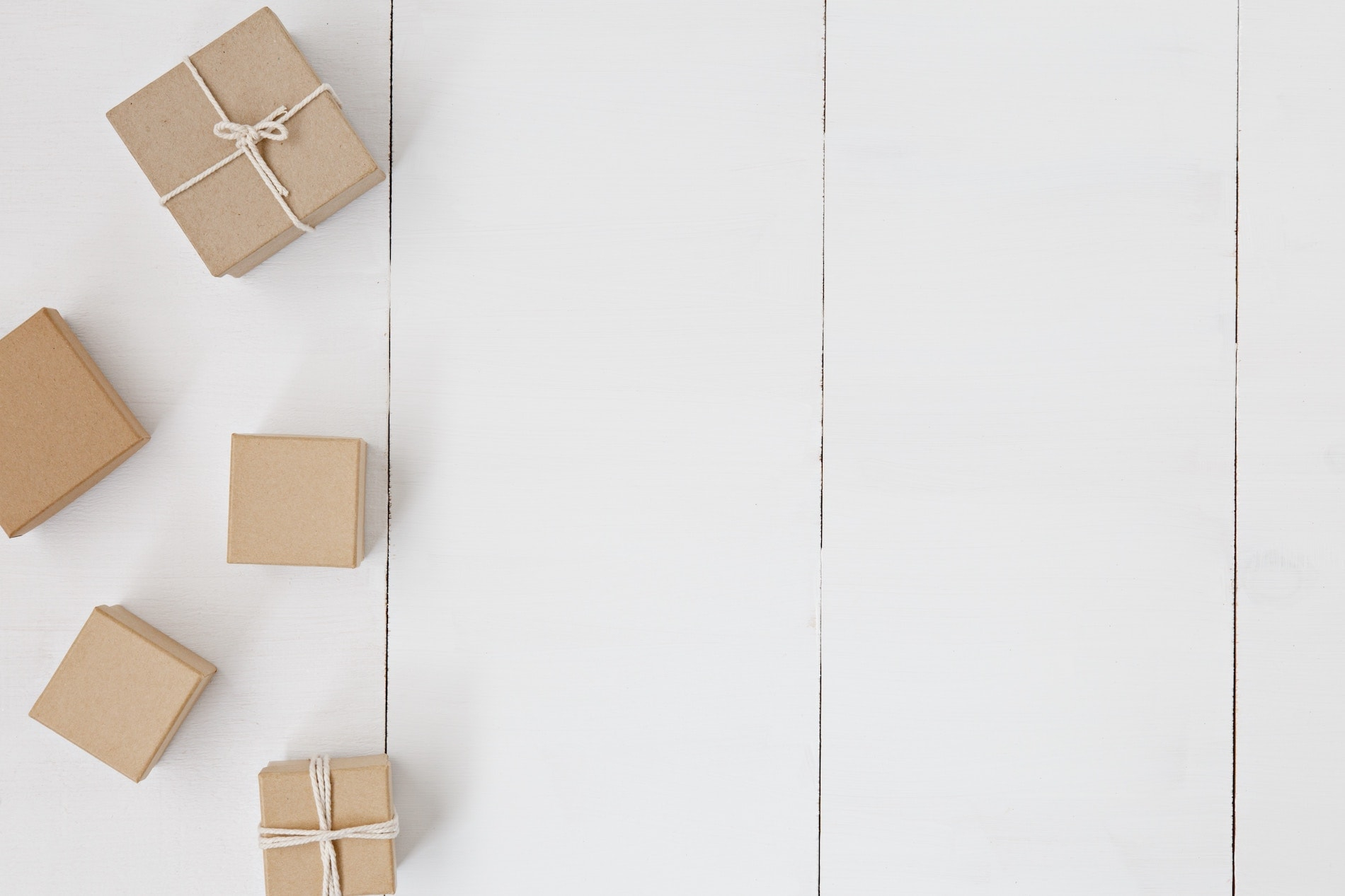 Brown cardboard boxes tied with string