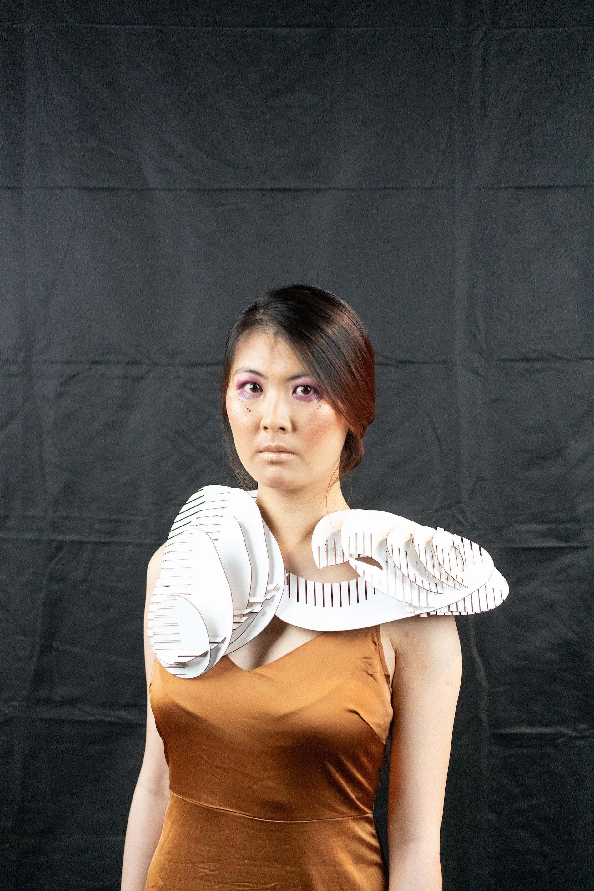 Model with cardboard cutout ornament