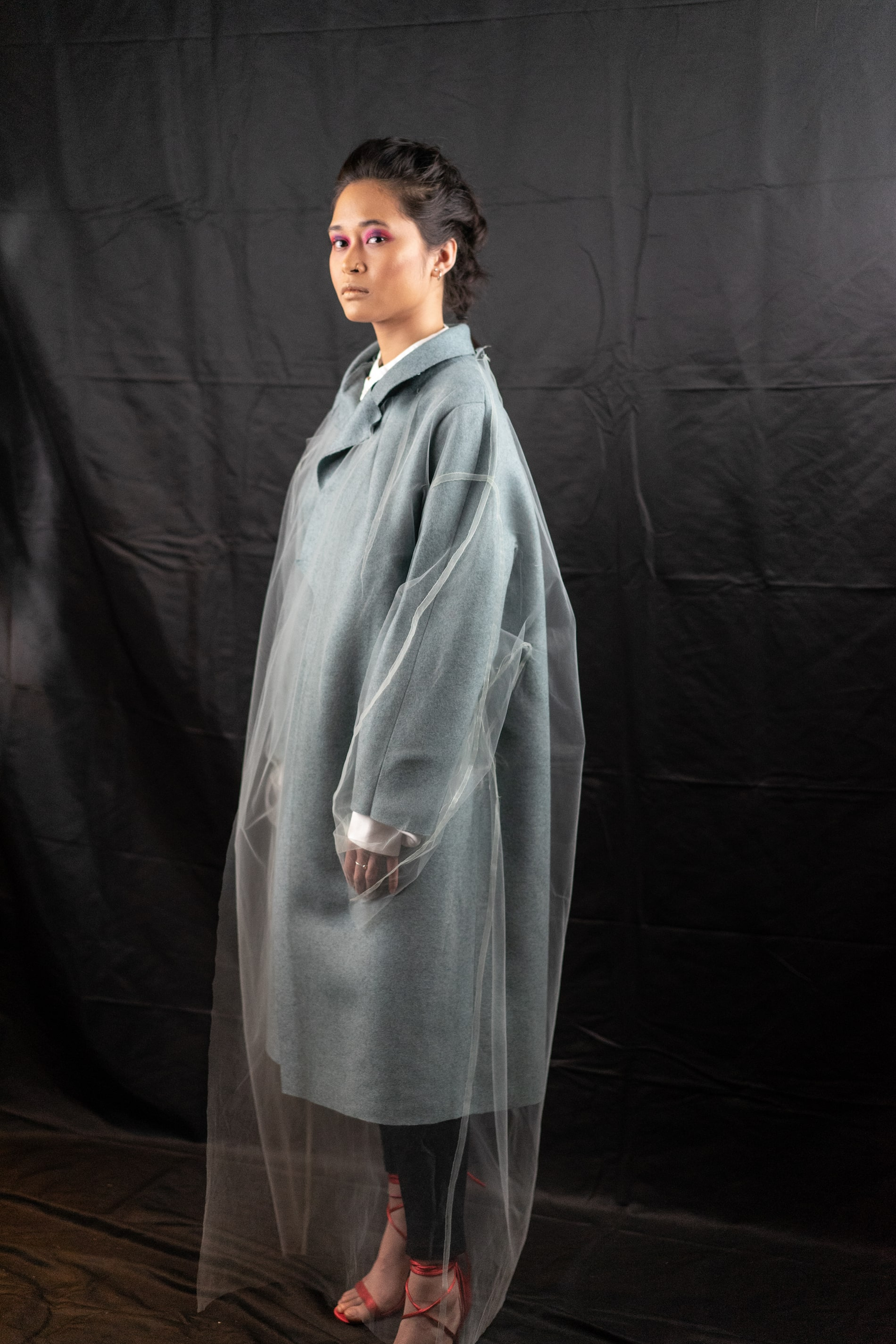 Model dressed in grey trench coast