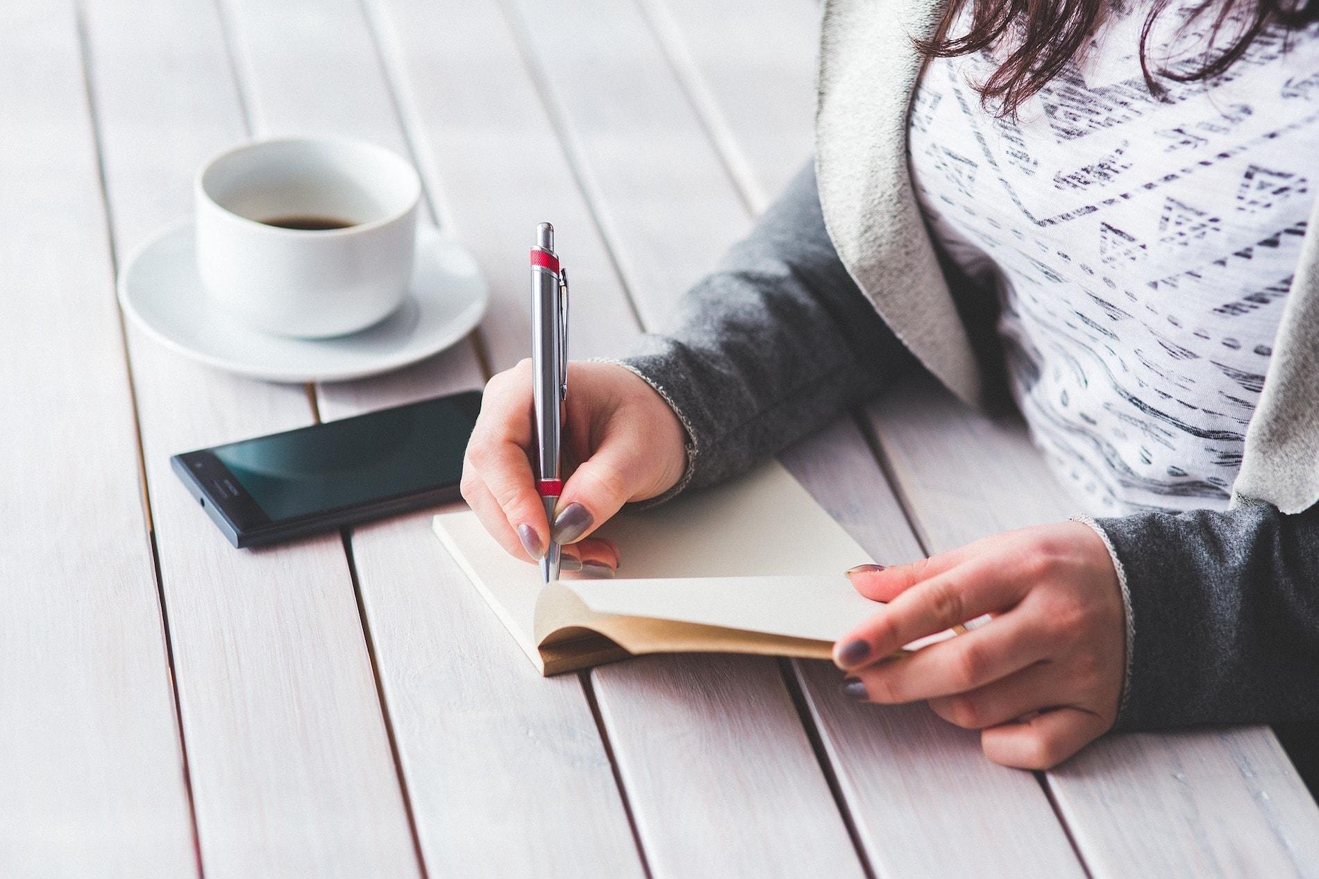 Women writing in notebook